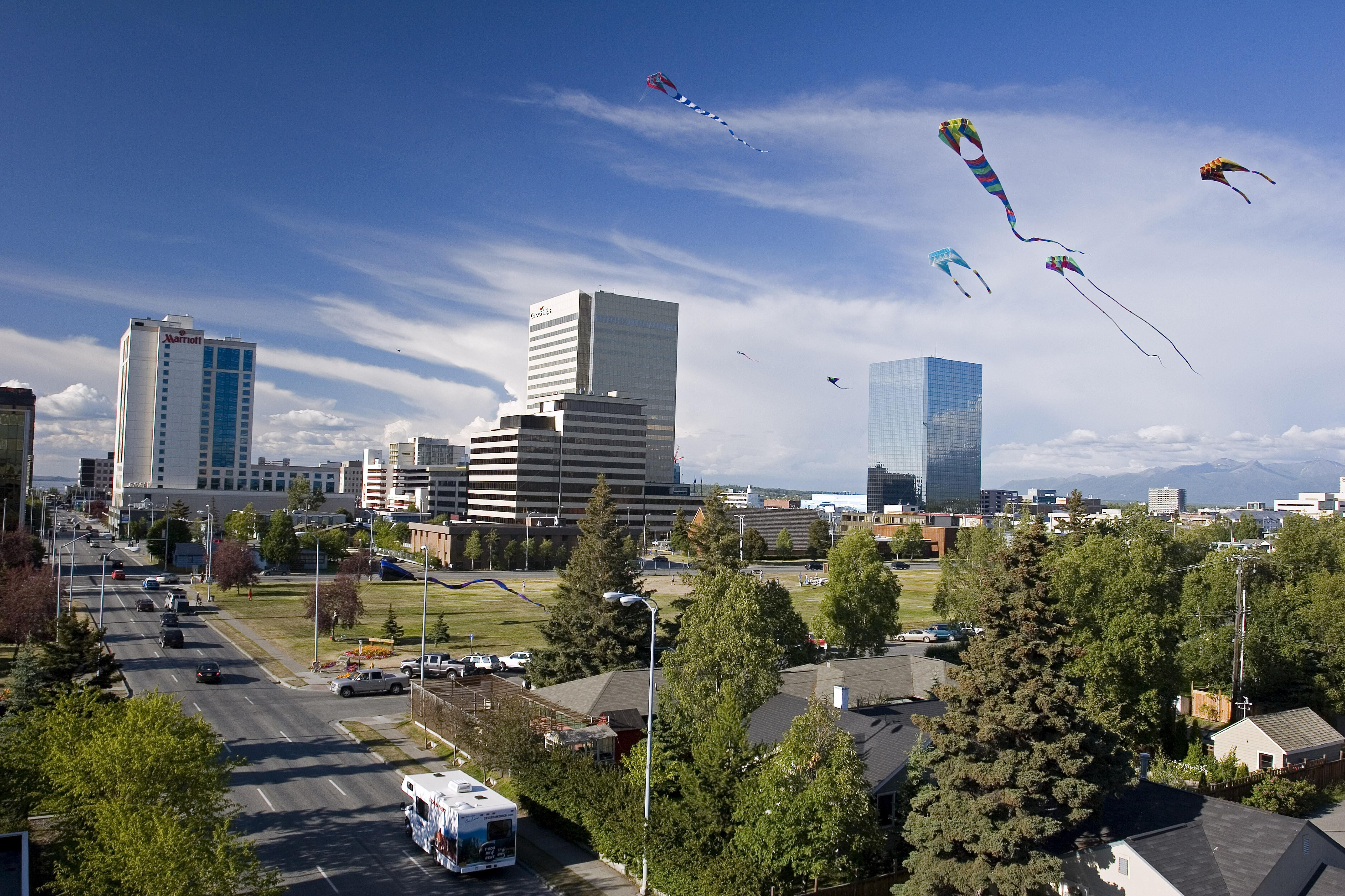 Birds-eye view of Anchorage with kites in the sky.