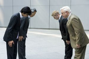 Japanese and Western men bowing to each other