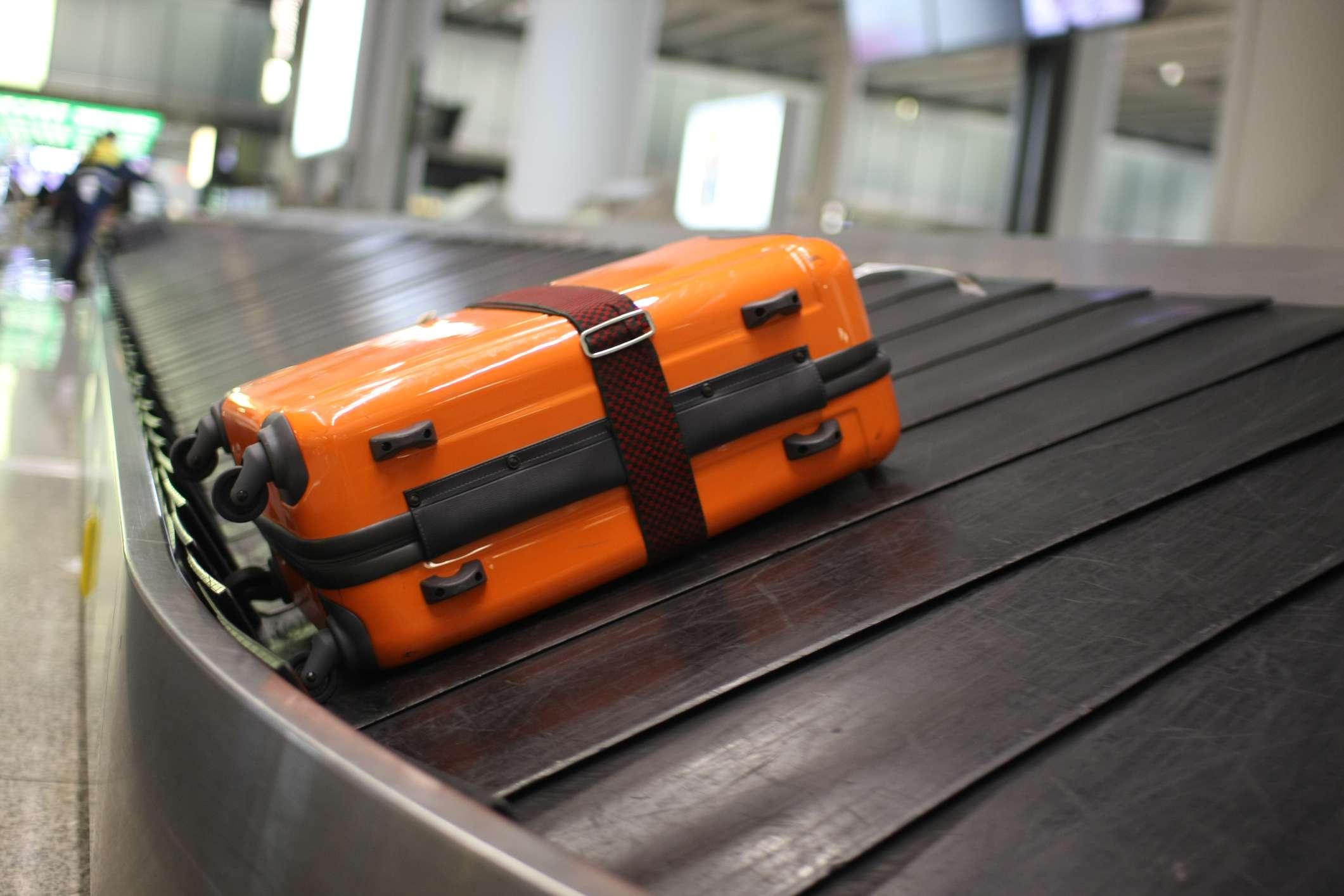 A piece of luggage on a baggage return belt