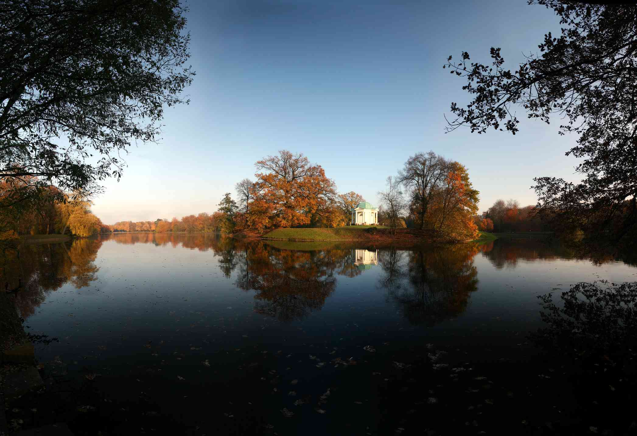 large lake surrounded by trees in autumn in Kassel, Germany's Staatspark Karlsaue