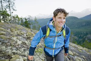 Man hiking uphill in summer
