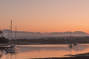 Scenic view of lake against orange sky,Mapua,New Zealand