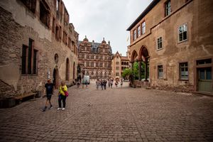 People walking around inside Heidelberg Castle