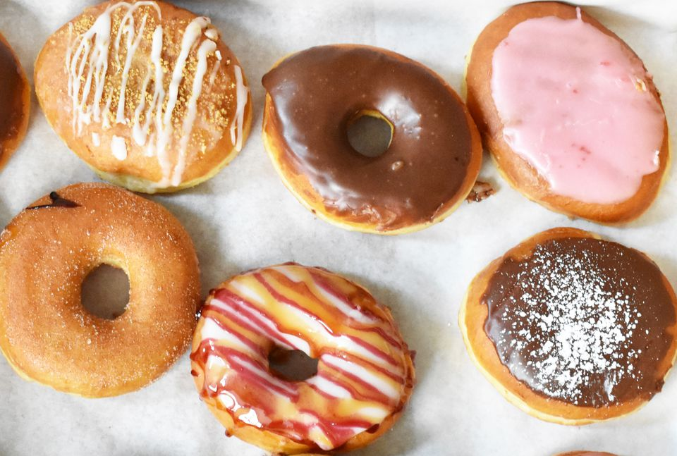 Assortment of six classic glazed and frosted donuts