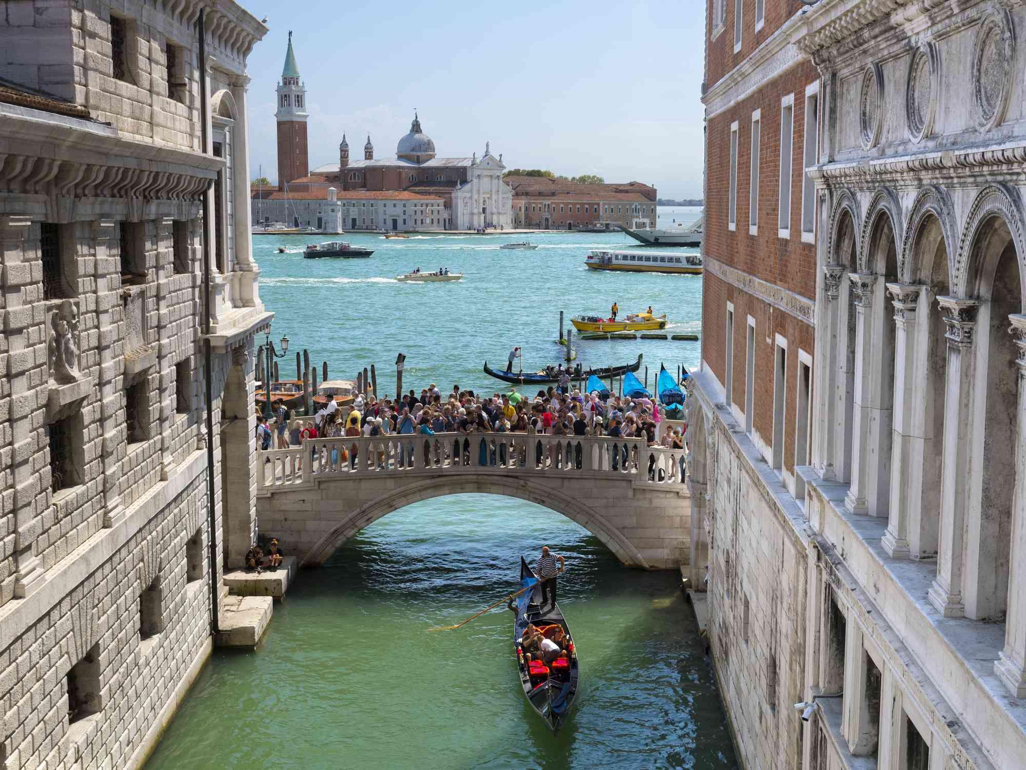 A group of tourists on the Ponte della Paglia, Venice