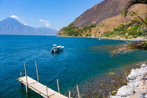 A boat coasting around the lake
