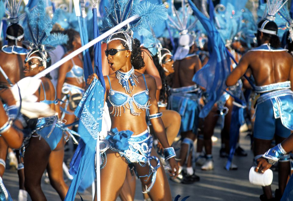 Masqueraders dressed in elaborate costumes taking part in Carnival in Trinidad