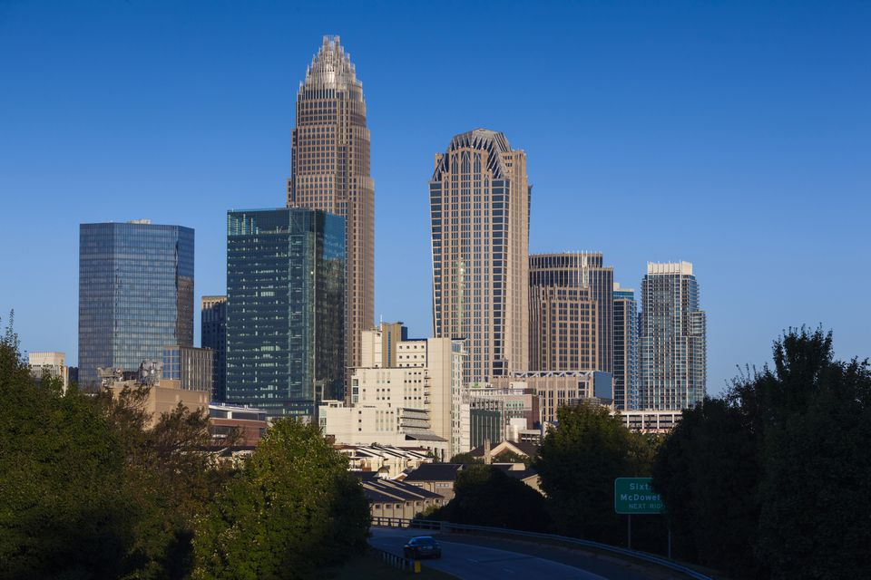 USA, North Carolina, Charlotte, elevated view of the city skyline from Route 74, morning