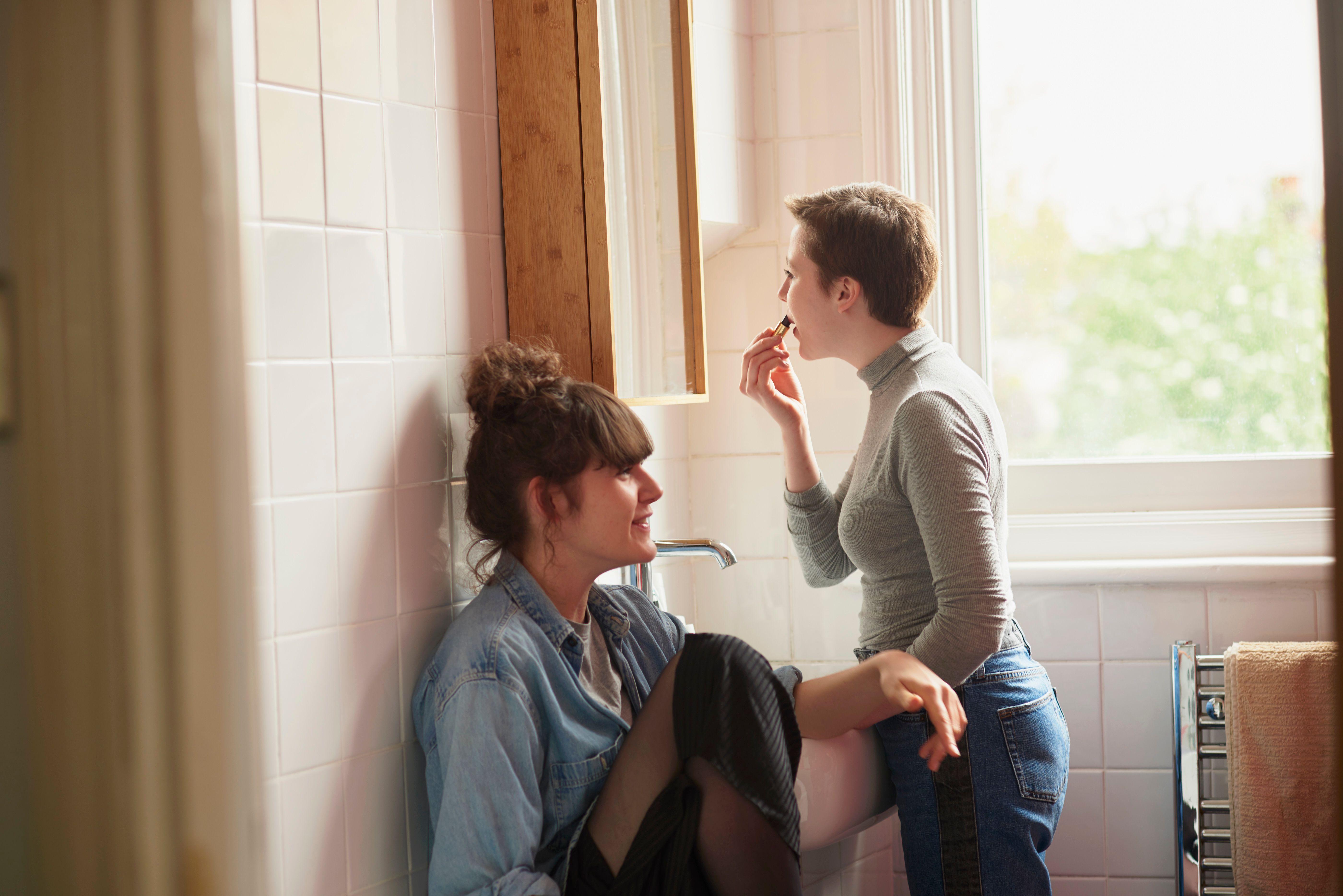 Friends chatting in bathroom
