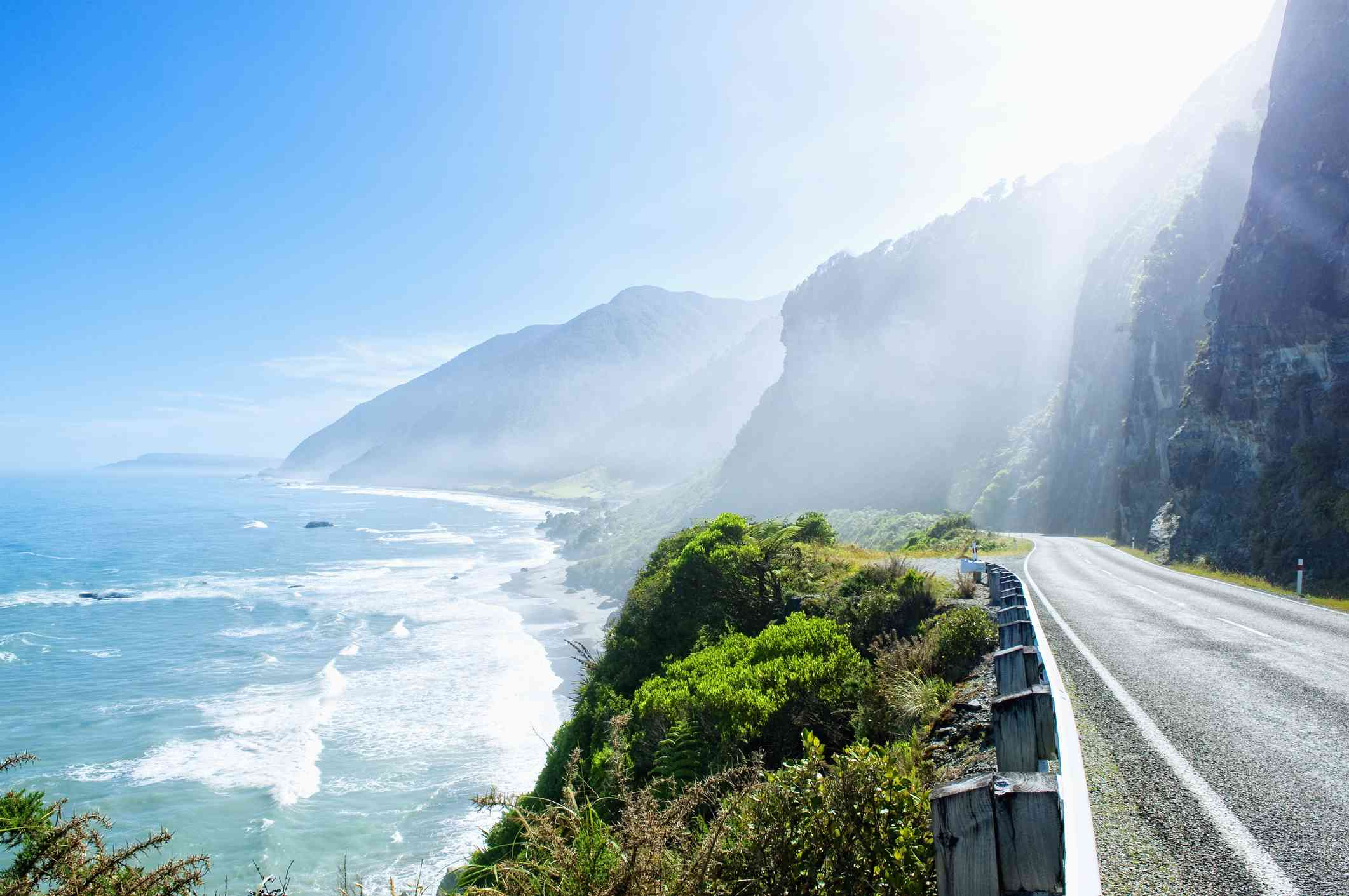 coastal road with waves and steep cliffs