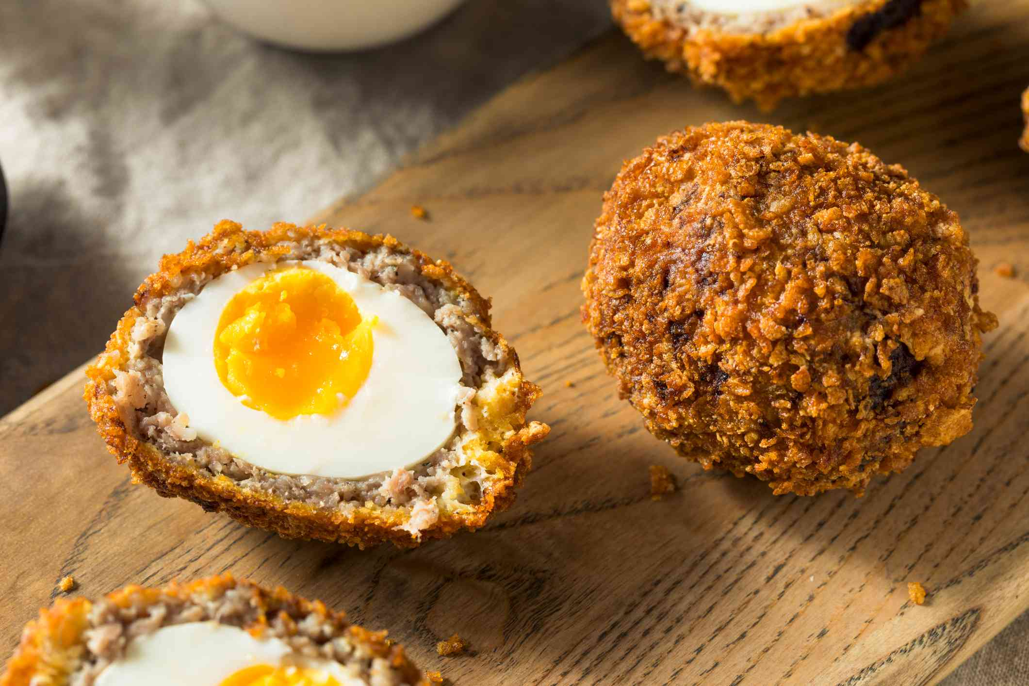 egg wrapped in sausage meat and crumbs and deep fried