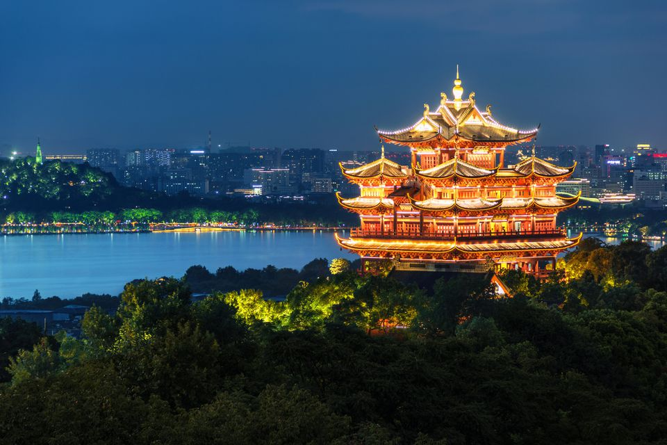 Illuminated Chenghuang Pagoda against West Lake,Hangzhou,China