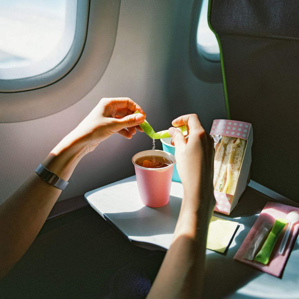 Woman eating her own food on airplane