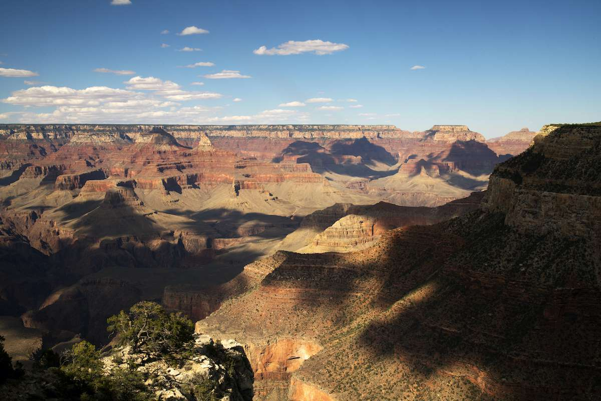 Shadows cover the open expanse of the Grand Canyon