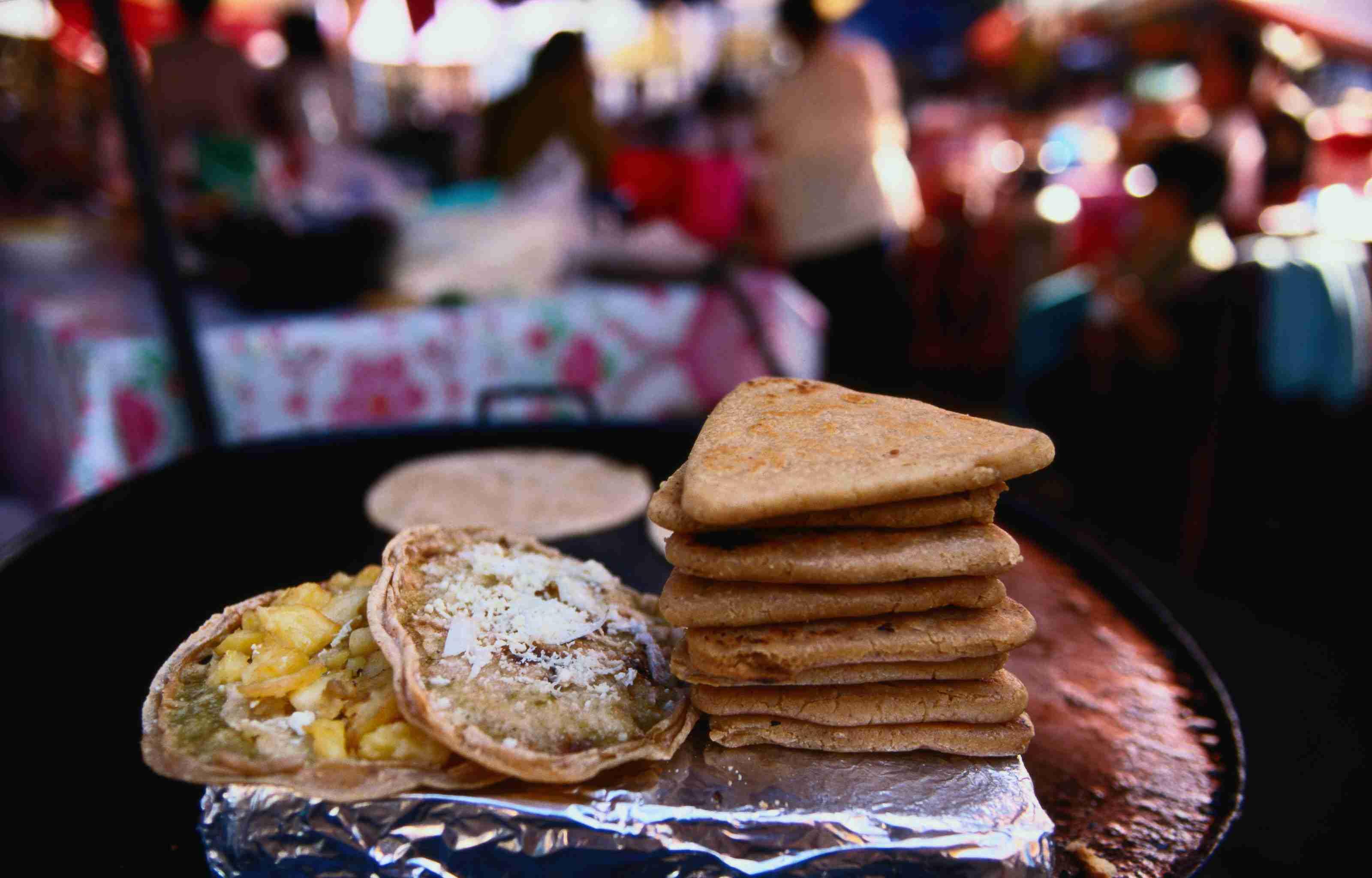 Chitacates (triangle shapes) and sopes from the market - Tepoztlan, Mexico