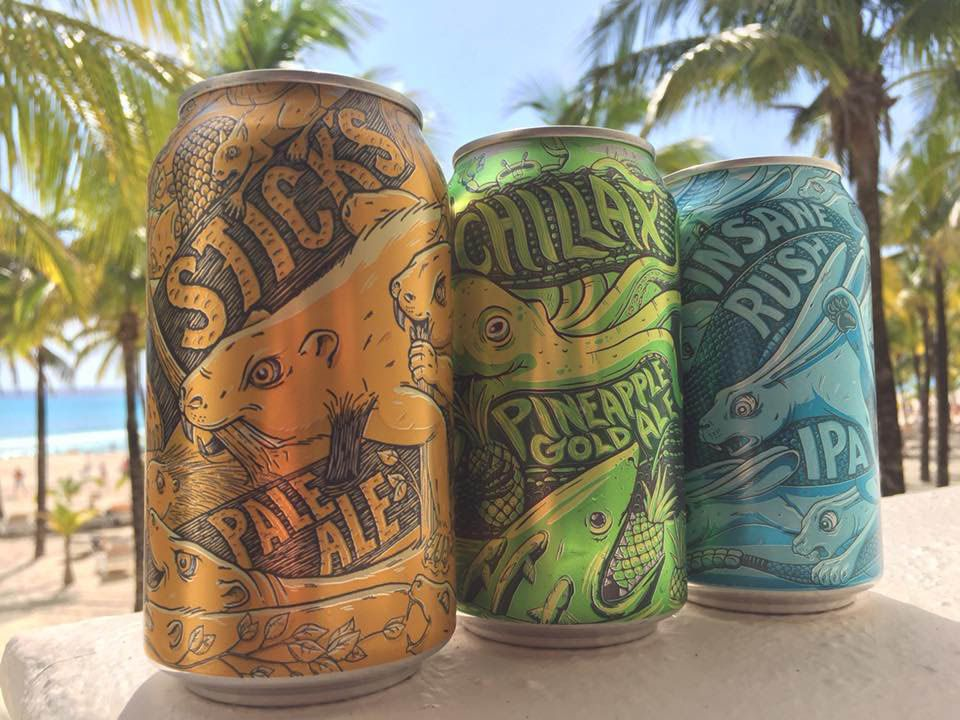 Three colorful beer cans with illustrated animals
