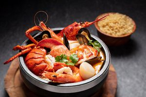 Pot of clams, langoustines, prawns, scallops and broth.