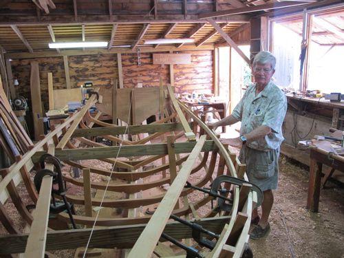 Abaco, Bahamas boat builder Joe Albury, owner of Joe's Studio on Man O War Cay, with one of his creations.