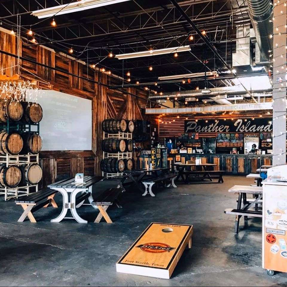 interior of Panther Island Brewing with wooden walls and an industrial ceiling