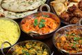 Bowls of curries, rice, chicken and naan, Indian cuisine