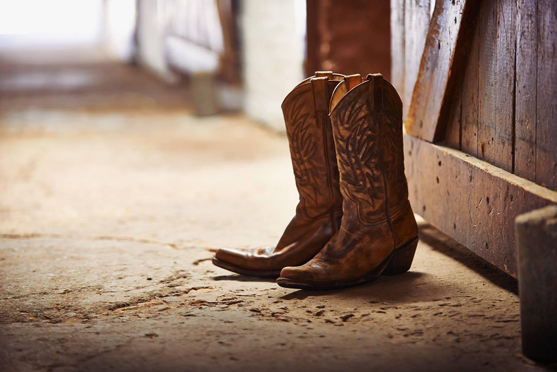 Cowboy boots in barn