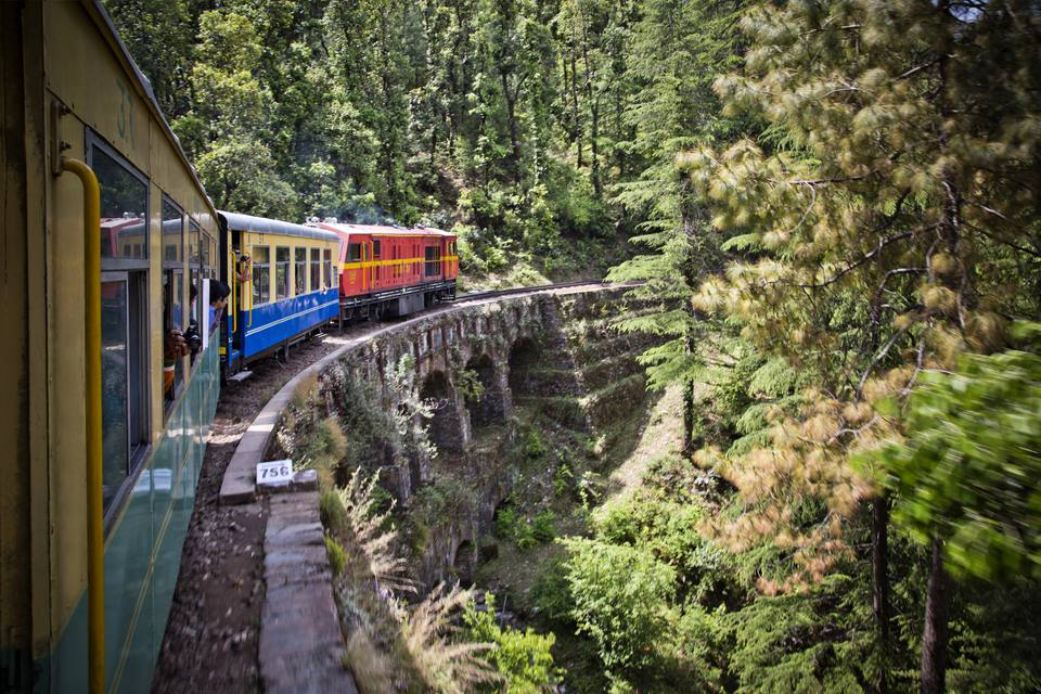 Train moving on railroad track in valley, Shimla, Himachal Pradesh
