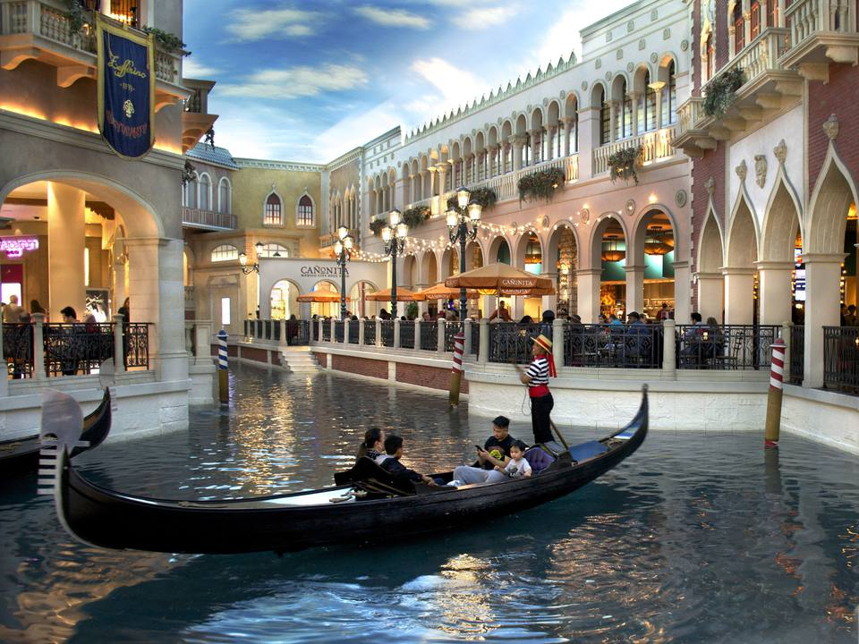 Tourists ride in a gondola inside the Venetian luxury hotel, casino and shopping complex on the Las Vegas Strip in Las Vegas, Nevada