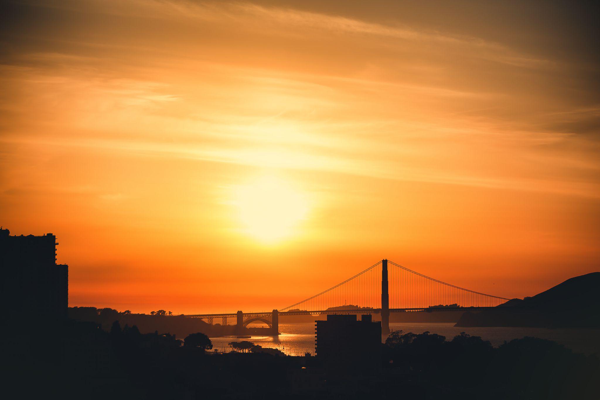 Silhouette Bay Bridge Against Orange Sunset Sky Seen From Coit Tower