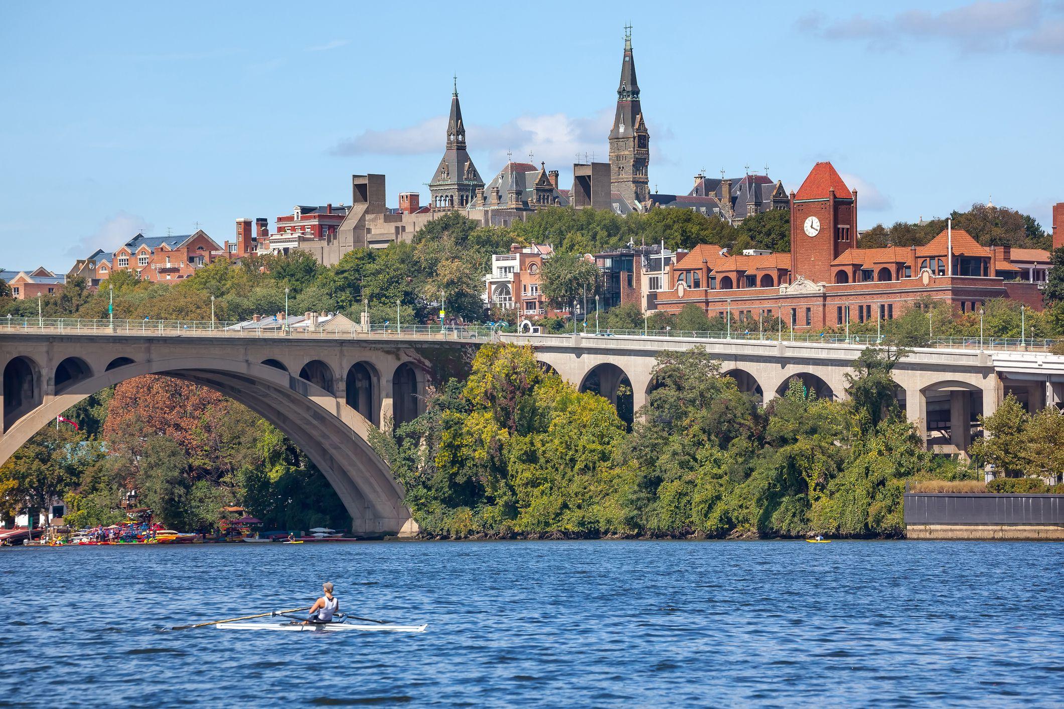 Potomac River with Key Bridge above and Georgetown University, Washington DC, USA