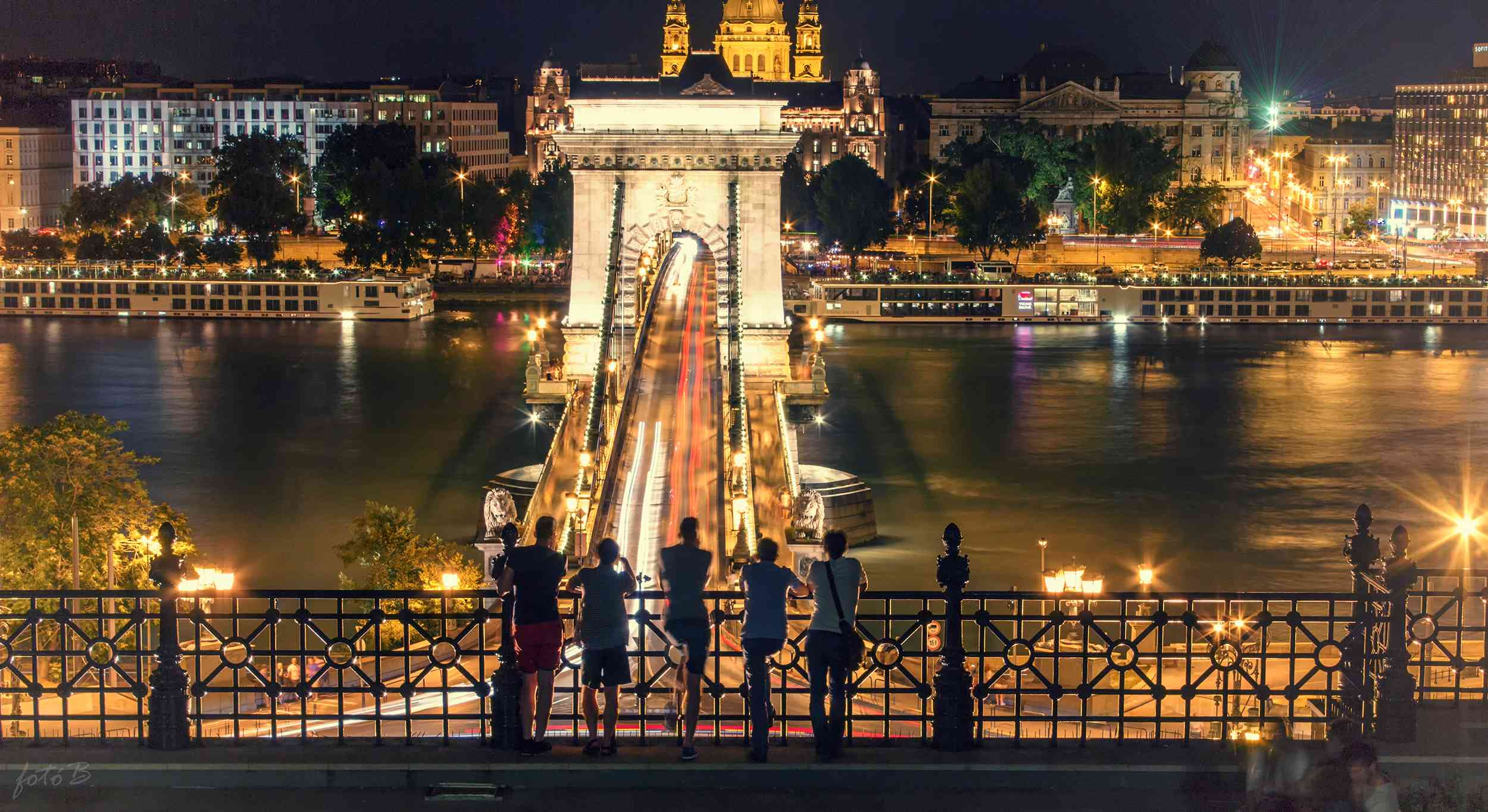 High Angle View Of Friends Standing Against Szechenyi Chain Bridge At Night