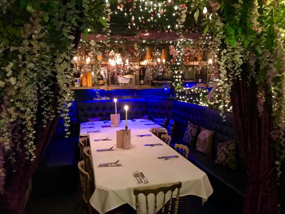 hanging plants around candlelit table