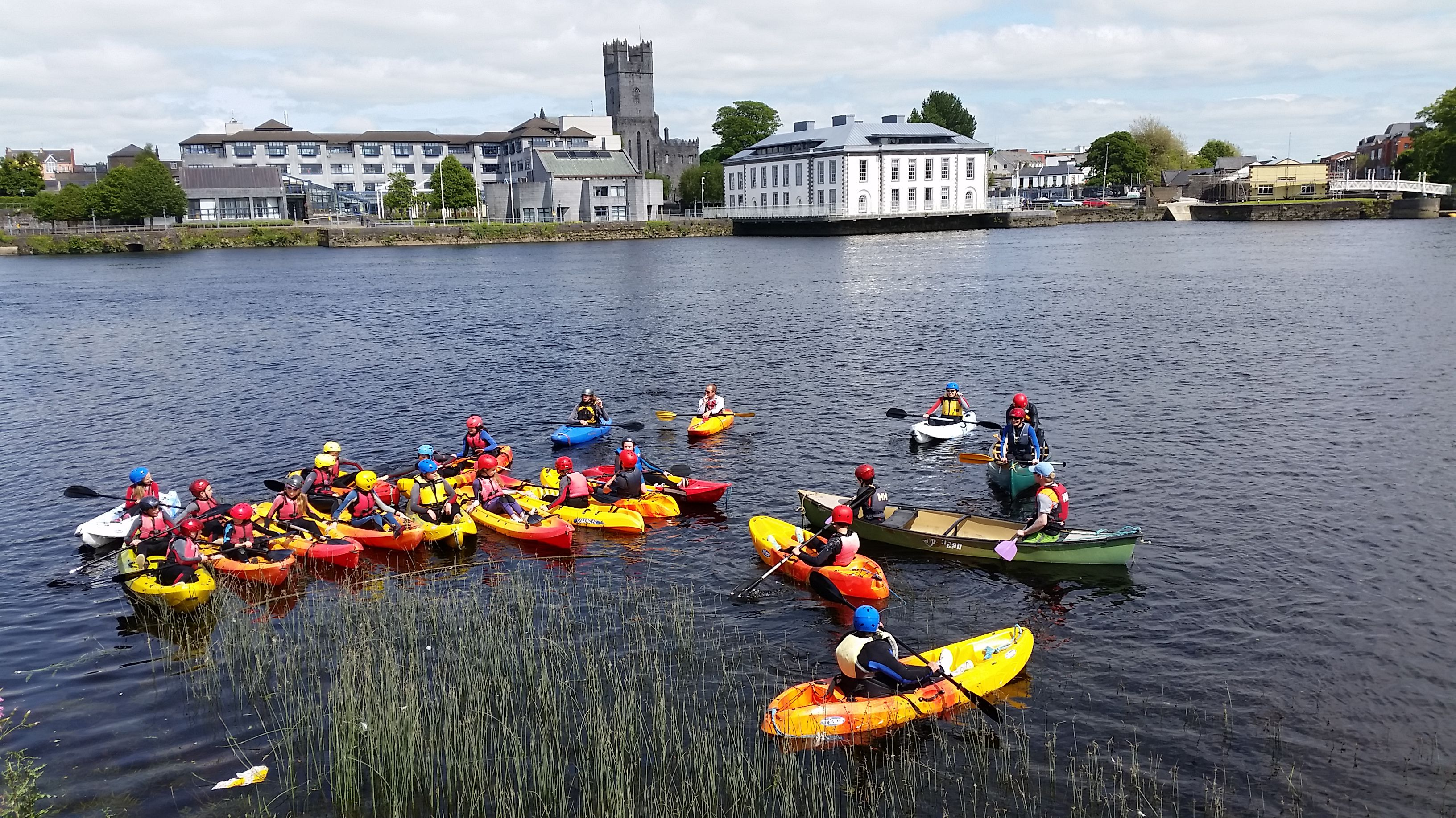 Kayaks on the Shannon river with Limerick in the background