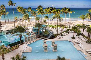 view of the pool and the beach at San Juan Marriott Resort & Stellaris Casino