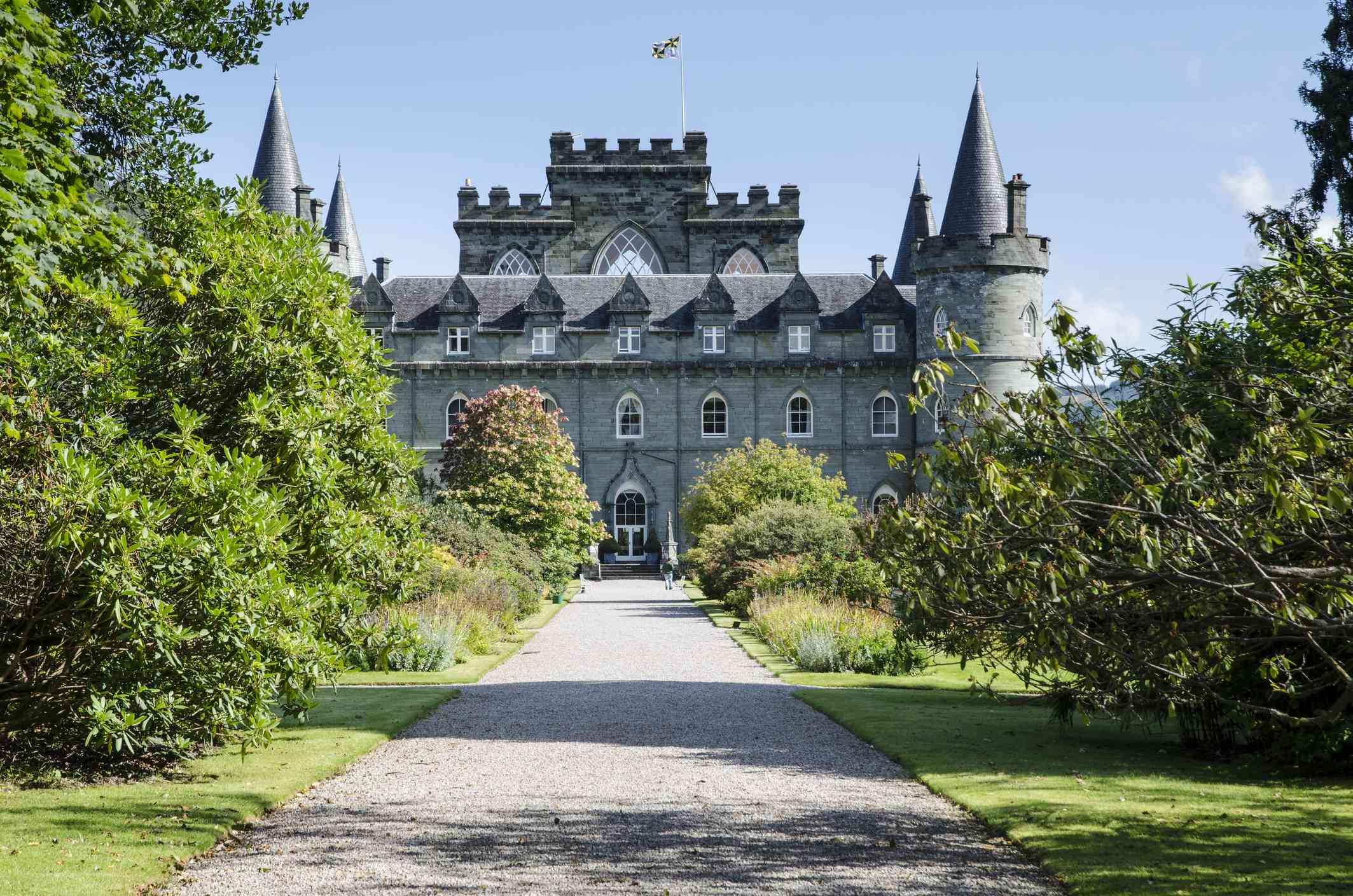 tree-lined gravel path leading to the neo-Gothic style Inveraray Castle