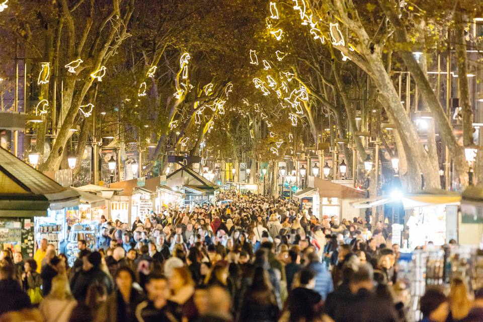 people walking at la rambla street during christmas and new year holidays in barcelona catalonia