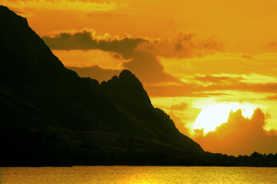 """There's no better time or place for a sunset stroll than as the sun sets behind Mount Makana (also known as """"Bali Hai"""" on the North Shore of Kauai."""