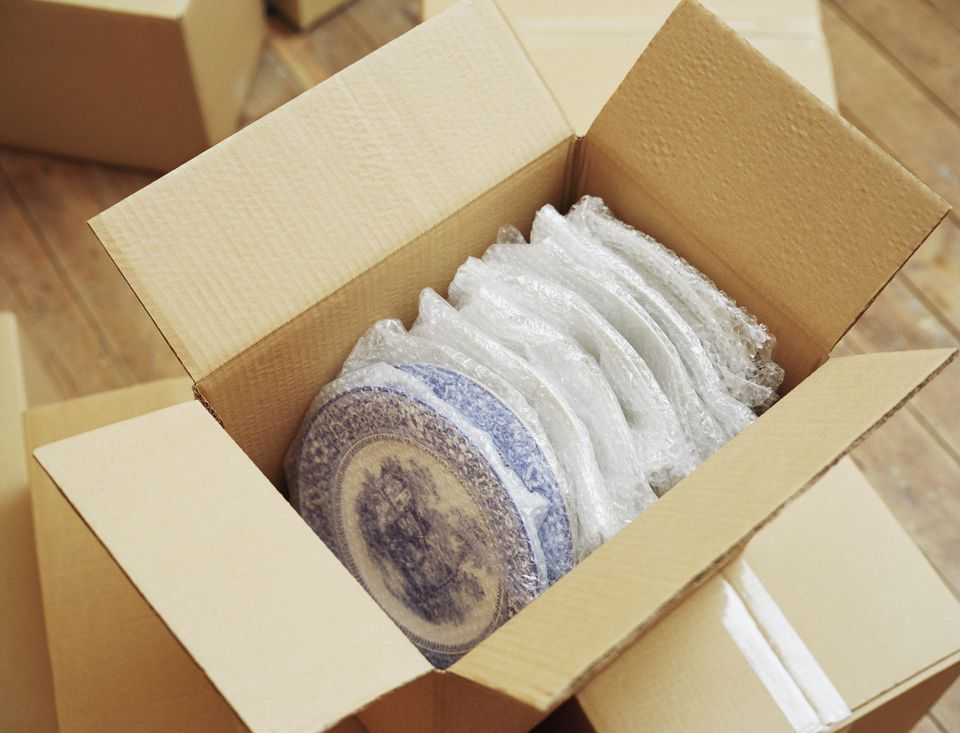Dinner plates packed in a box.