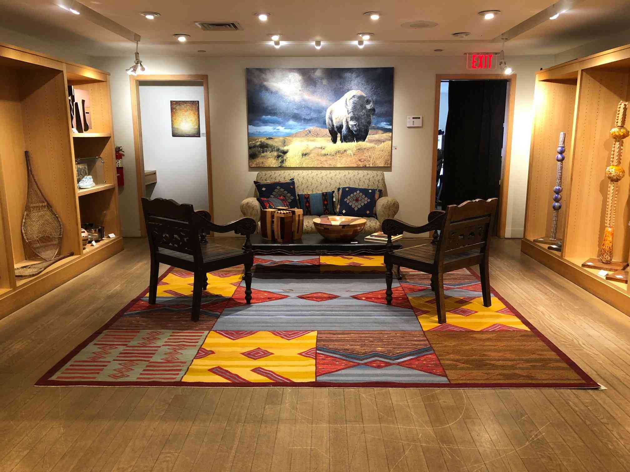 Chairs and couch on a rug in Santa Fe's True West Gallery