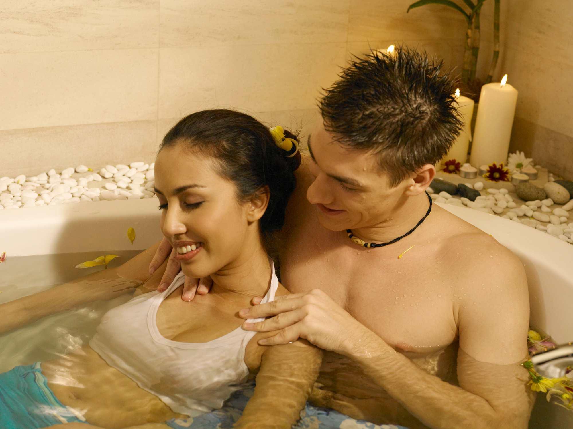 Shirtless Boyfriend Giving Massage To Girlfriend In Bathtub