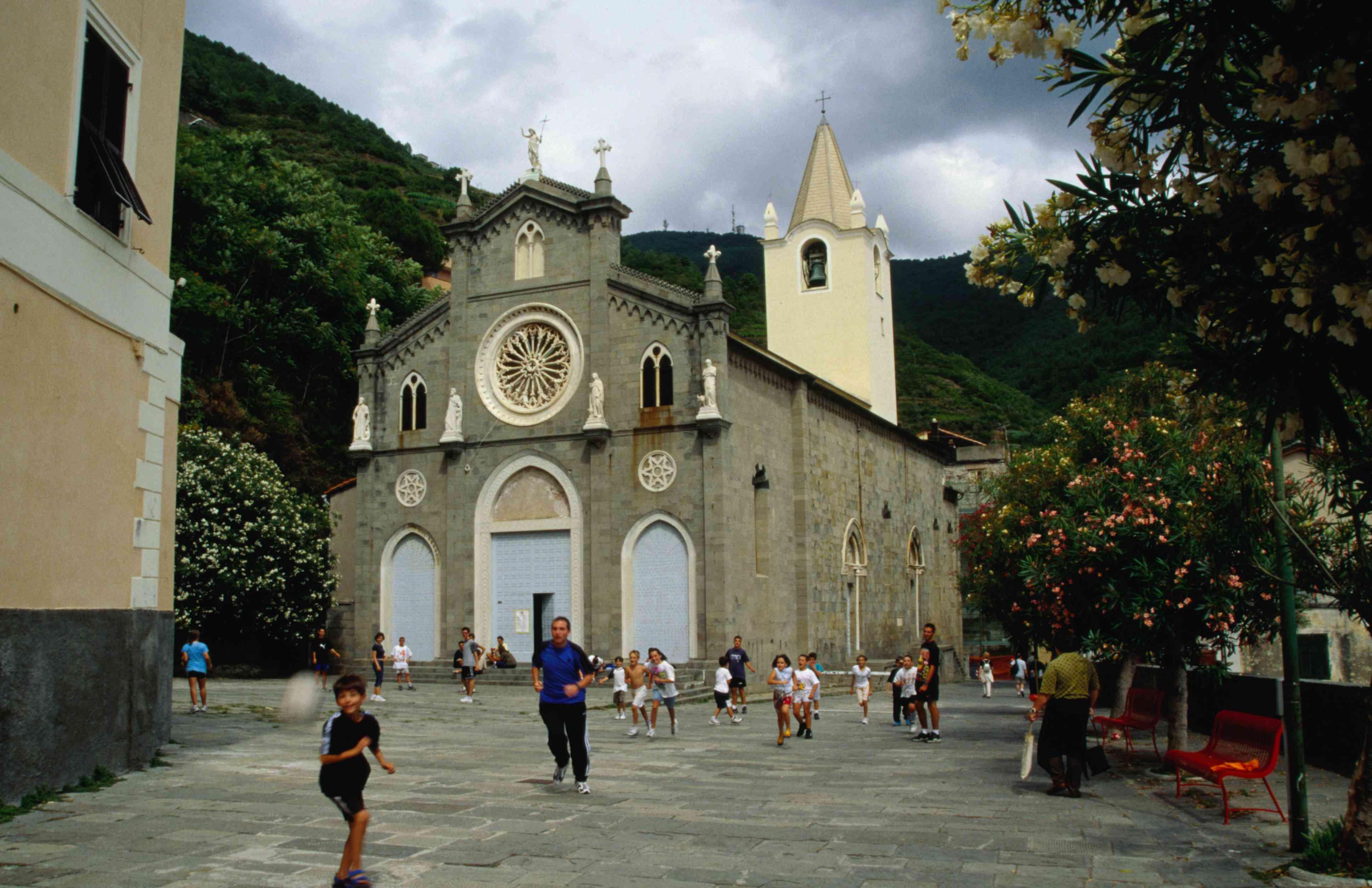 Kids playing in front of San Giovanni Battista church, Riomaggiore