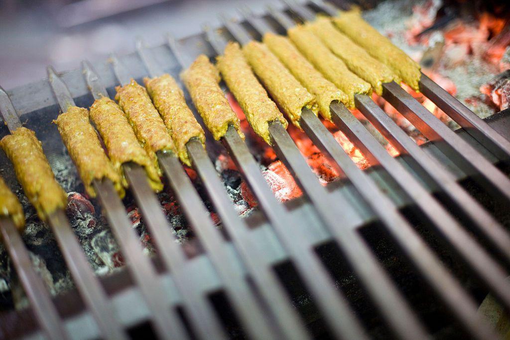 Cooking Indian kebabs.