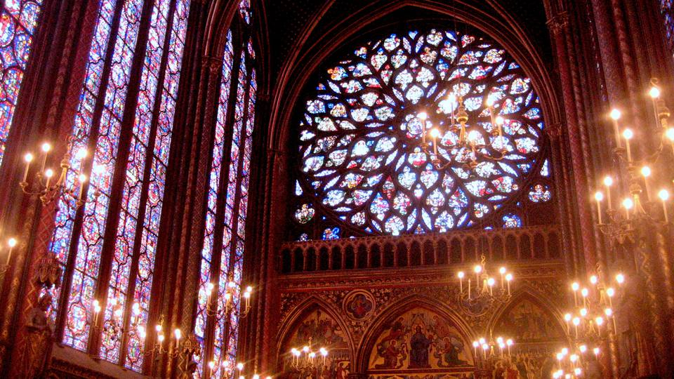 The Western Rose Window at the Sainte-Chapelle in Paris depicts the biblical Apocalypse of St John.