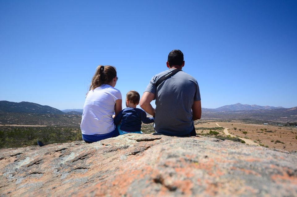 Family sitting on top of a rock in South Africa