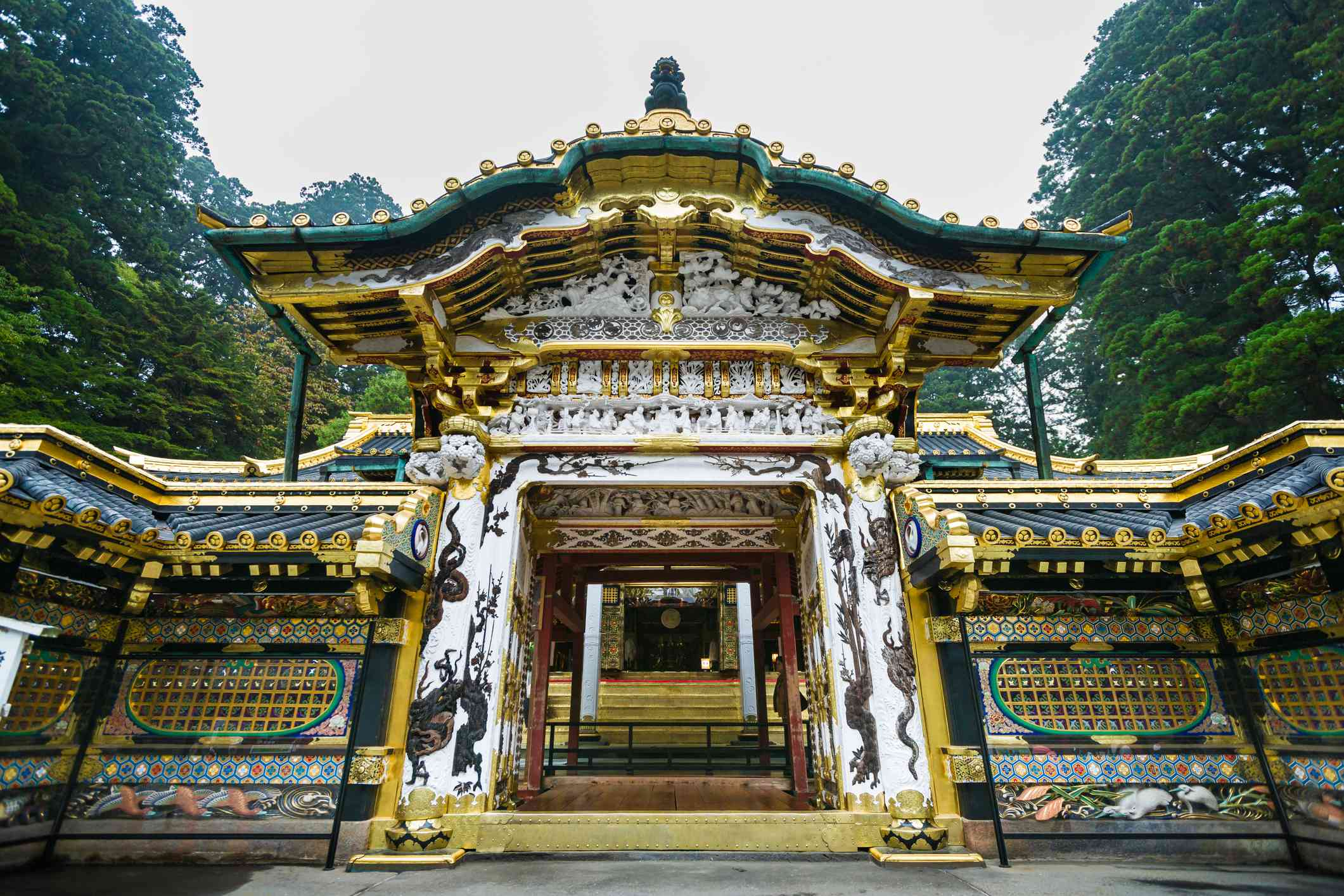 The Karamon at Tosho-gu Shrine Mausoleum surrounded by cedar forest in rainy morning.