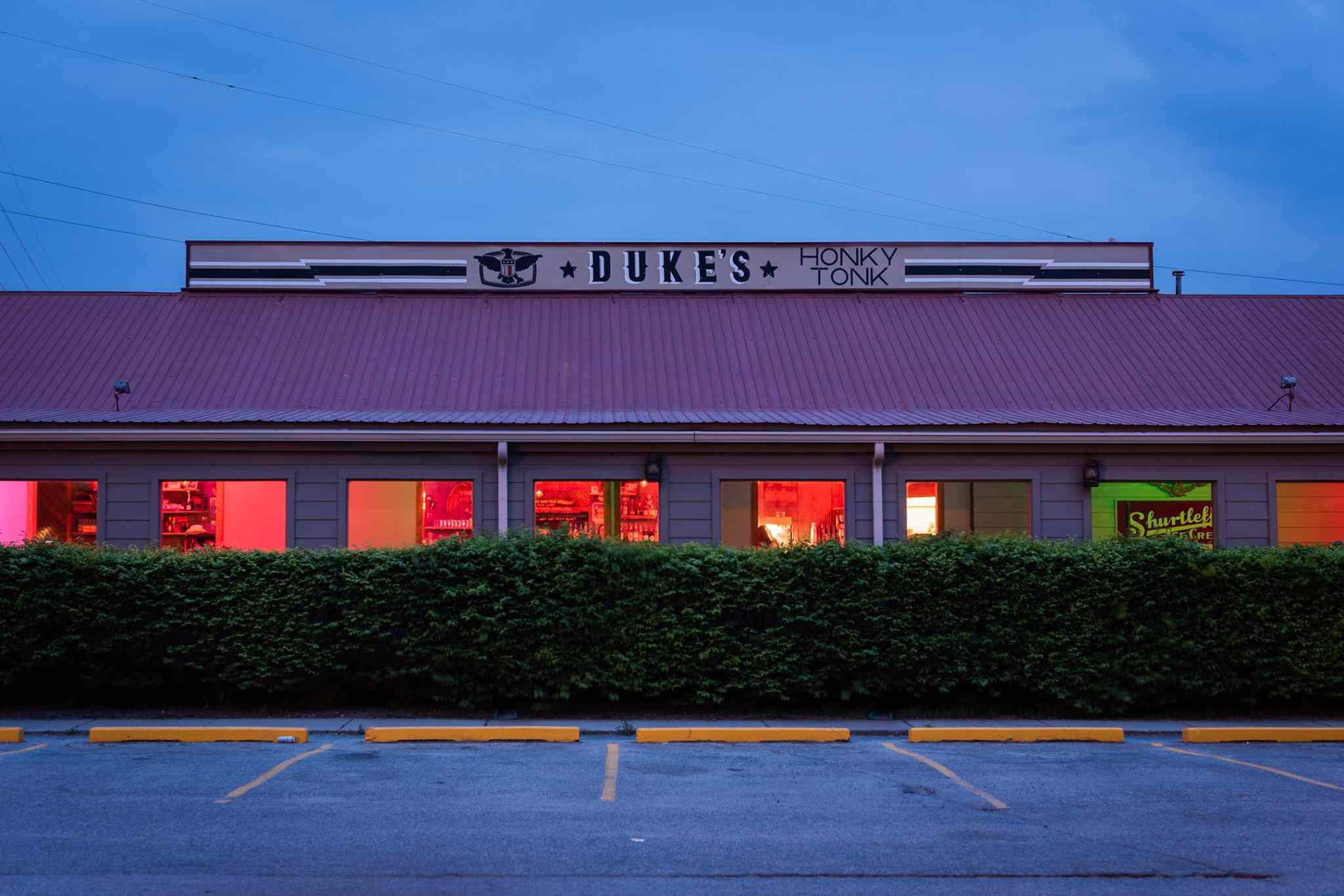 Exterior of Duke's Indy bar at twilight