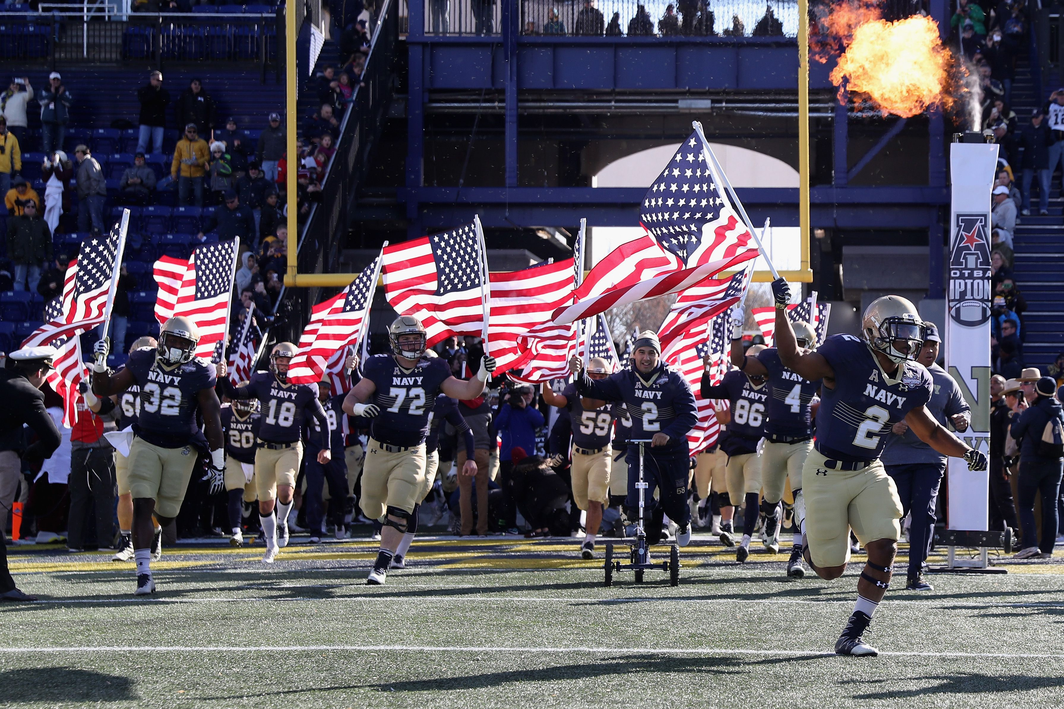 The Navy Midshipmen take the field before the start of a game