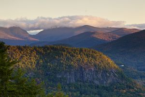 Tree covered mountains of Pinkham Notch and the Mount Washington Valley seen at sunset