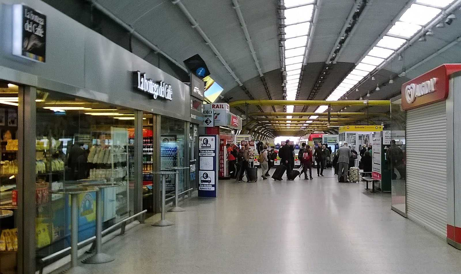 Shops and travelers at Athens International Airport