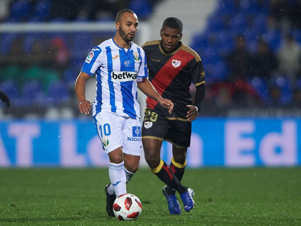 Nabil El Zhar of Leganes competes for the ball with Akieme of Rayo Vallecano during the Copa del Rey match between Leganes and Rayo Vallecano at Estadio Municipal de Butarque on October 30, 2018 in Leganes, Spain.