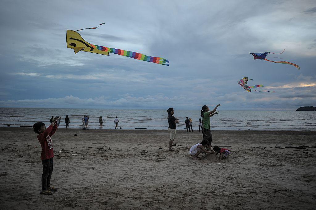 Kite flying on Kinabalu beach, Malaysia